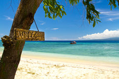 Welcome sign to paradise beach and sea on island Royalty Free Stock Photos