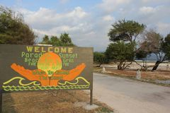 Welcome sign to Paradise sunset beach Royalty Free Stock Photos