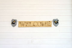 Welcome sign vintage style on white wooden plank wall Stock Photo