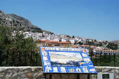 Welcome sign and white town, Valle de Abdalajis. Stock Photos
