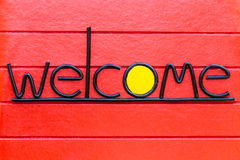 Welcome Sign on Wood Wall. Welcome Sign on Red Wood Wall Stock Image
