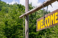 Welcome sign on wooden board stock images