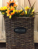 Welcome sign on woven basket Royalty Free Stock Image