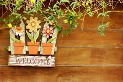 Welcome  signboard on wooden fence in garden Stock Image