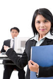 Welcome sir!. A woman employee welcoming a guest or a secretary welcoming a guest to meet the boss or even a businesswoman welcoming her partners to come in. It Stock Photos