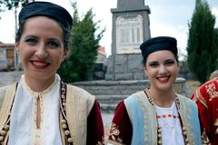 Welcome smile. Beautiful dancers and singers at the nice folk style evening meal in Montenegro royalty free stock photography