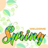 Welcome spring, abstract background. With lettering in vivid spring colors and decorative flowers Stock Photo