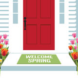 Welcome spring front door with tulips Royalty Free Stock Photo