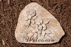 Welcome Stepping Stone on Pine Straw Stock Image