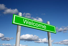 Welcome street sign. Welcome road sign, sky and clouds in the background Royalty Free Stock Photo