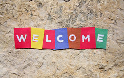 Welcome symbol. On the rock of entrance Stock Image