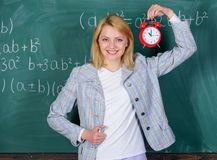 Welcome teacher school year. Looking committed teacher complement qualified workforce educators. School discipline. Concept. Woman teacher hold alarm clock. She royalty free stock images