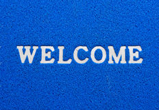 Welcome text. Text on textured  blue background Stock Image