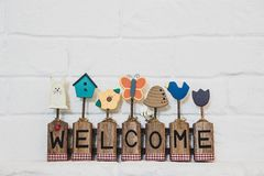 Welcome text lable on wall background stock photos
