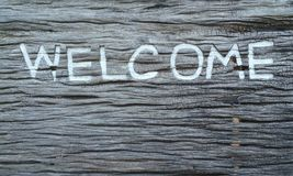 Welcome text on the wooden background Royalty Free Stock Image