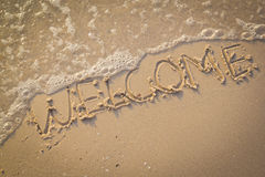Welcome, texture on the beach sand. Royalty Free Stock Image