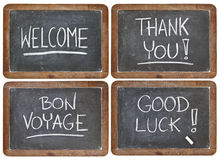 Welcome, thank you,, good luck. Welcome, thank you, bon voyage, good luck - white chalk handwriting on vintage slate blackboard - a collage of 4 isolated images royalty free stock images