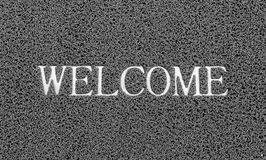 Welcome title on the gray plastic doormat for texture background Stock Photography