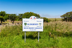 Welcome to Alderney Sign. Bilingual welcome sign near the airport of Alderney, Channel Islands, UK Royalty Free Stock Image