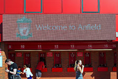 Welcome to Anfield sign and people buying tickets at Liverpool Football Club Stadium. Liverpool Stock Photo