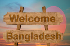 Welcome to  Bangladesh sing on wood background with blending national flag Stock Image