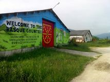 Welcome to the Basque Country mural on an outbuilding in Spain. stock photo
