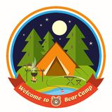 Welcome To Bear Camp badge. Welcome To Bear Camp circular colored vector badge with a drawing of a tent in a forest at night with a cooking fire and fishing rod Stock Image