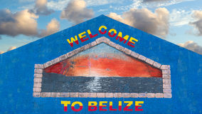 Welcome to Belize. Colorful welcome sign painted on the wall of a building in Belize against a pretty tropical sky Stock Photography