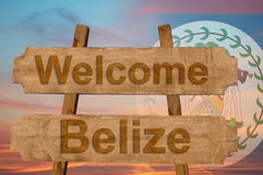 Welcome to  Belize sing on wood background with blending national flag Stock Images