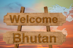 Welcome to  Bhutan sing on wood background with blending national flag Stock Photo