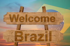 Welcome to  Brazil sing on wood background with blending national flag Stock Image