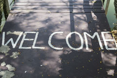 Welcome. Welcome to the bridge across the river Royalty Free Stock Images