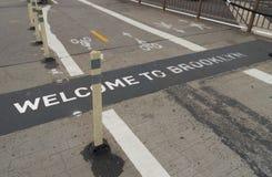 Welcome to brooklyn. Sign on the brooklyn bridge walkway Stock Photos