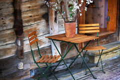 Welcome to Bryggen. A wooden table and chairs on a porch of an old house in the old hanseatic town of Bryggen, Norway Stock Photos