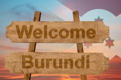 Welcome to  Burundi sing on wood background with blending national flag Stock Photography