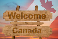 Welcome to Canada sing on wood background with blending national flag Royalty Free Stock Photography