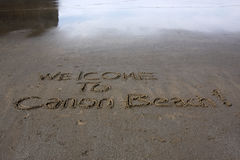 Welcome to Canon Beach!. A writing on a sandy beach at Cannon Beach Oregon Coast Royalty Free Stock Photo
