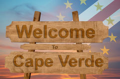 Welcome to Cape Verde sing on wood background with blending national flag Royalty Free Stock Photos