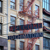 Welcome to Chinatown. NEW YORK, NY, USA - FALL 2014: Sign reading Welcome to Chinatown on a historic building on Canal Street, New York, NY, USA in Fall 2014 stock photo