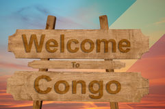 Welcome to Congo sing on wood background with blending national flag Royalty Free Stock Photography