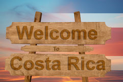 Welcome to Costa Rica sing on wood background with blending national flag Stock Photos