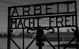 Welcome to Dachau. This sign welcomed the prisoners to Dachau. It reads work sets you free Stock Photo