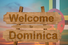 Welcome to Dominica sing on wood background with blending national flag Royalty Free Stock Photography