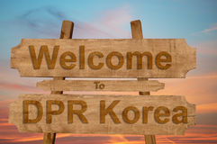 Welcome to DPR Korea sing on wood background Stock Photo