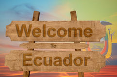 Welcome to Ecuador   sing on wood background with blending national flag Stock Images