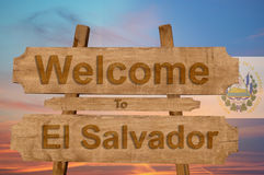 Welcome to El Salvador sing on wood background with blending national flag Stock Image