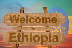 Welcome to Ethiopia sing on wood background with blending national flag Stock Image