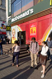 Welcome to euro cup 212  in Kiev!. KIEV,UKRAINE-MAY 01: Customers enter and exit a Euro 2012-branded a McDonald's Corp. restaurant  on May 1, 2012 in Kiev Stock Image