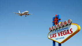 Welcome to Fabulous Las Vegas Sign with Arriving Airplane Royalty Free Stock Image