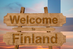 Welcome to Finland sing on wood background with blending national flag Stock Image
